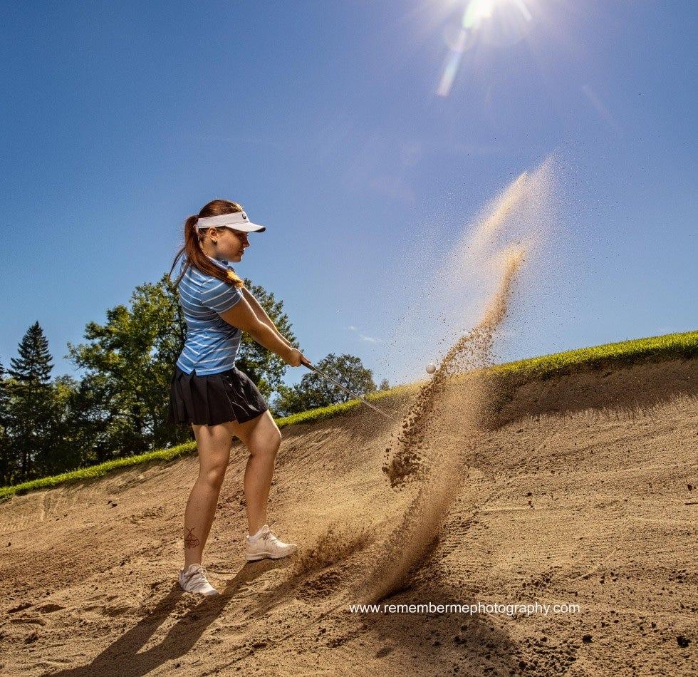 senior girl golfer sand shot